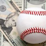 baseball dollar bills representing how much d1 colleges spend on baseball