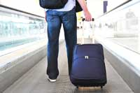 student with suitcase representing colleges with most geographic diversity