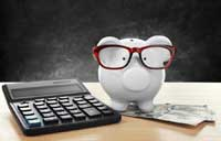 Piggy bank with calculator and money reprenting what you need to know about net price calculators
