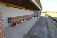 empty baseball dugout representing division 2 baseball colleges