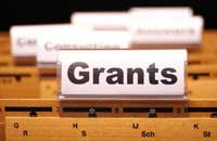 "file folder titled ""grants"" representing colleges providing the most financial aid by state"