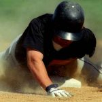 player sliding into base representing ways to get smart about college baseball recruiting