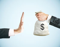 hand rejecting bag of money representing applying to colleges without generous merit aid